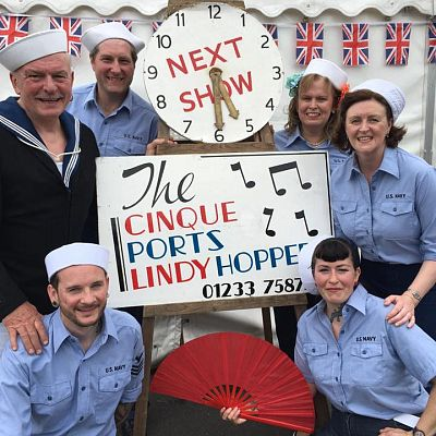 Cinque Ports Lindy Hoppers: Tenterden KESR 1940s Steam weekend May 2016 - Messing about in Deck Sailor outfits: Jim & Jenny, Dapper Dru & Sugarfoot Sophie, Gypsy John & Krazy Karen posing with the legendary CPLH clock