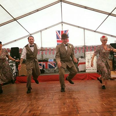 Cinque Ports Lindy Hoppers: Tenterden KESR 1940s Steam weekend May 2016 - Sugarfoot Sophie, Dapper Dru, Gypsy John and Jan tapping the Gooofus Tap Shim Sham - Photo courtesy of My Favourite Things